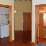Laundry room convenient to roomy foyer. Second full bath.