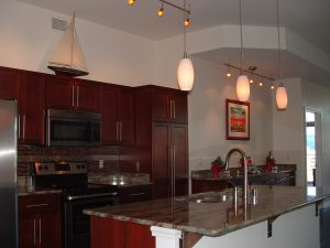 A breakfast bar is often part of a condo kitchen. Some feature an island sink.