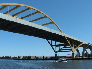 Boat passing under the Hoan bridge, and into Milwaukee's harbor.