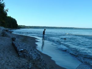 A boy on a beach, one of many public parks along the Lake Michigan shore.